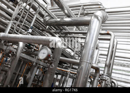 Equipment, cables and piping found inside of modern industrial power plant - Stock Photo