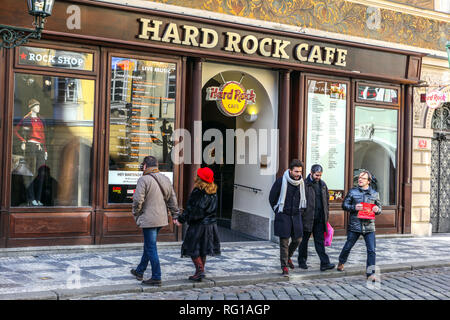Tourists in front of famous bar Hard Rock Cafe on Male Namesti Square, Prague Old Town Little Square Czech Republic - Stock Photo