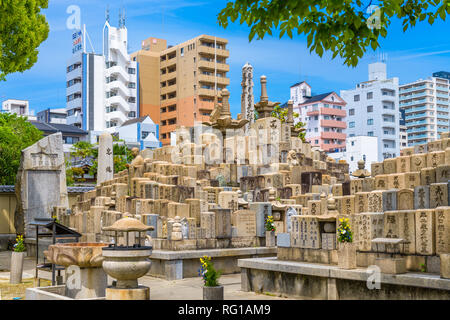 OSAKA, JAPAN - MAY 6, 2014: Graves at Shitennoji Temple in Osaka Japan. The temple is noted as the first officially sanctioned religious establishment