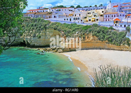 PRAIA DO CARVOEIRO, PORTUGAL - Nice view from top of the rock to the beach with nice white sand and turquoise water to swim and relax - Stock Photo