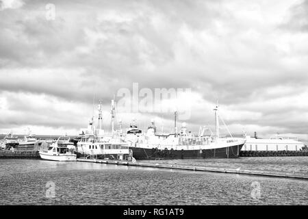 Reykjavik, Iceland - October 13, 2017: sea port with ships. Travel by ship. Sea port terminal. Proud to be your gateway to the gulf. Everything for travel. - Stock Photo