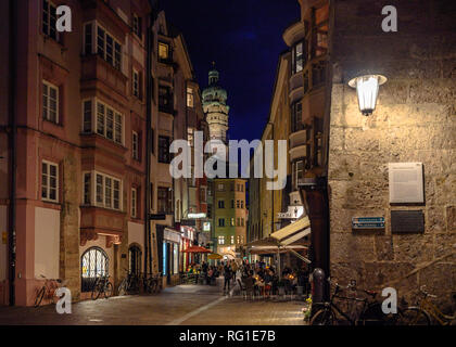 An evening scene with cafe terraces in the old town of Innsbruck, Austria - Stock Photo