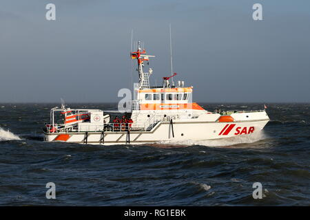 The SAR ship Anneliese Kramer passes on January 1, 2019 the port of Cuxhaven in a stormy sea. - Stock Photo
