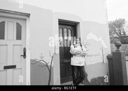 Reykjavik, Iceland - October 12, 2017: man stand at apartment. Bearded man travel abroad. Active man rent apartment house. Travel to meet yourself. - Stock Photo