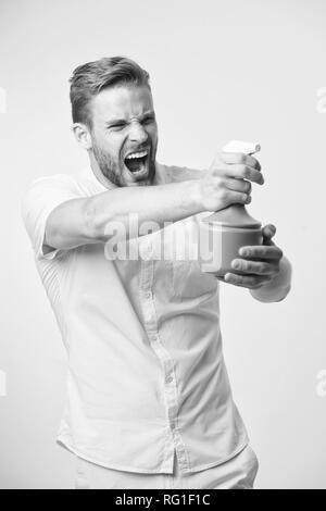 Macho hold plastic spray bottle as gun yellow background. Guy with water spray in hand pretend shooting attack. Housework and sanitary concept. Take care about moisturizing. Moisturizing concept. - Stock Photo