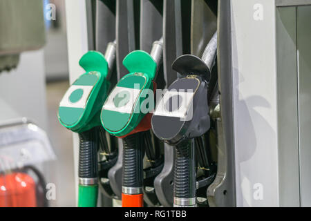 Colorful Petrol pump filling nozzles , Gas station in a service - Stock Photo