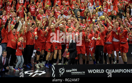Herning, Denmark. 27th Jan, 2019. Handball: WM, final round, final, Denmark - Norway. Denmark's players cheer at the award ceremony while goalkeeper Niklas Landin raises the World Cup trophy. Denmark becomes Handball World Champion for the first time in history. Credit: Axel Heimken/dpa/Alamy Live News - Stock Photo
