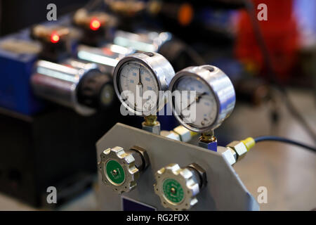 Hydraulic equipment with pressure gauges on an industrial machine. Selective focus. - Stock Photo