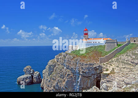 Nice landscape with lighthouse on cliffs in Sagres Portugal westernmost point of europe with blue sky - Stock Photo
