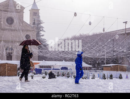 Woman and child, walking in snow during snowstorm, Avezzano, Abruzzo region, Italy, Europe - Stock Photo