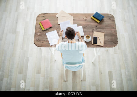 Man reading business papers Stock Photo