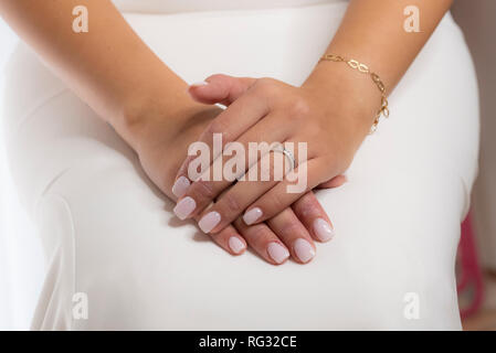 woman's hands with engagement ring for wedding - Stock Photo