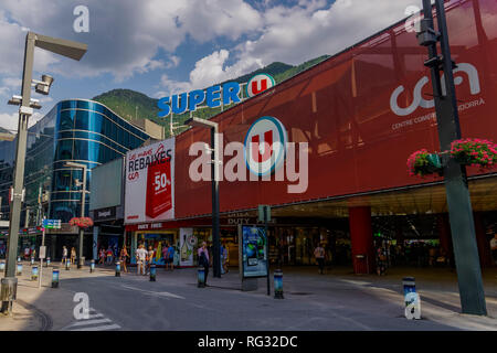 Andorra la Vella, Andorra Super U super market facade. Day view of CCA, Centre Comercial Andorra shopping mall and supermarket with duty free & crowd. - Stock Photo