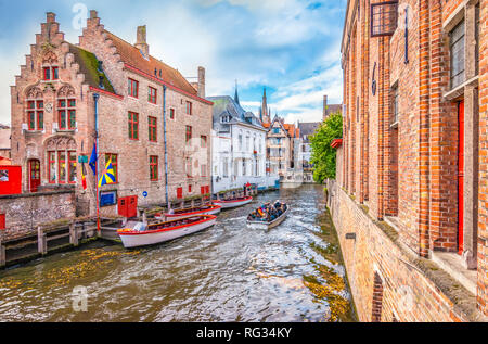 Boat trip on canal of Bruges. Popular for tourists who visit Belgium. - Stock Photo