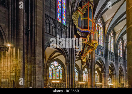 The great organ in swallow's nest in the cathedral of Strasbourg, France - Stock Photo