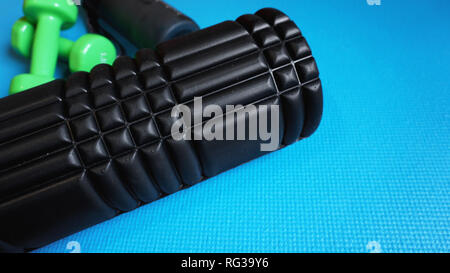 Foam Roller Gym Fitness Equipment Blue background self Myofascial Release - Stock Photo