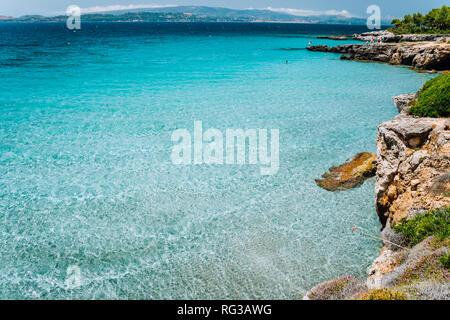 Cristal clear turquoise sea water. Seaside beach lagoon and scenery coastline of Kefalonia island, Mediterranean landscape. Ionian sea, Greece - Stock Photo