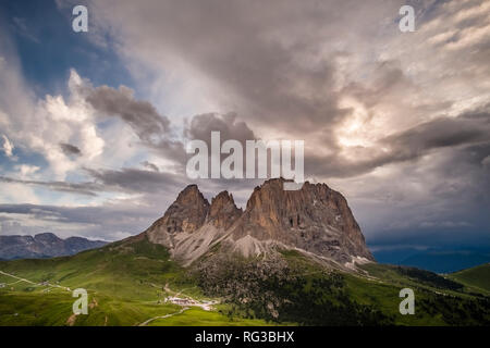 View on Saslonch, Sassolungo or Langkofel group from Sella Pass, Sellajoch, Passo Sella, dark thunderstorm clouds approaching - Stock Photo
