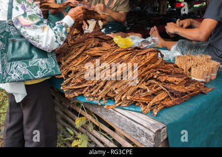 Dried tobacco leaves are for sale in a local market in Philippines. Malatapay street market, Zamboanguita, Negros Oriental, Philippines- September 2,  - Stock Photo