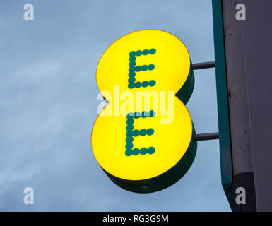 BT-owned mobile phone company EE signage outside one of its outlets in Putney, London, UK - Stock Photo
