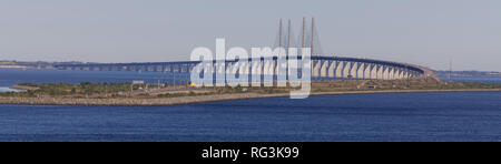 The Oresund Bridge which connects Denmark and Sweden with afternoon traffic - Stock Photo