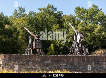 Medieval trebuchet at Chateau de Castelnaud, medieval fortress at Castelnaud-la-Chapelle, Dordogne, Aquitaine, France - Stock Photo