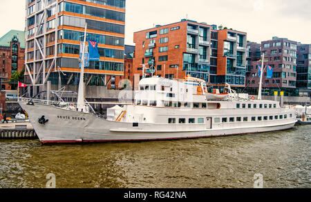 Hamburg, Germany - September 07, 2017: ship at ferry pier on cityscape background. River transport, transportation. Water travel, travelling trip Vacation discovery wanderlust - Stock Photo