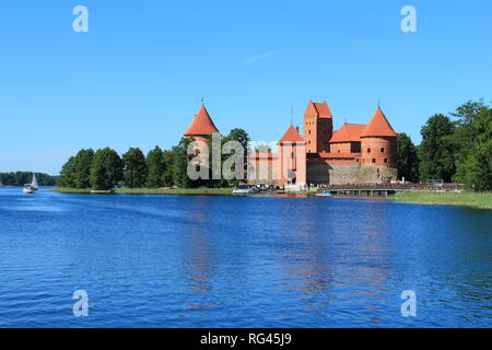 TRAKAI, LITHUANIA. Tourists visit city castle. This is a major attraction in Lithuania. - Stock Photo