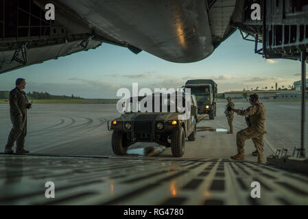 Air Force Reserve airmen load cargo onto a C-5M Super Galaxy with soldiers assigned to the 314th Military Intelligence Battalion, Military Intelligence Command at Marine Corps Base Hawaii, HI, January 27, 2019, during Exercise Patriot Palm. Exercise Patriot Palm is a joint-service exercise coordinated by the Air Force Reserve, designed to integrate first responders from federal, state, and local agencies and the military by providing quick response training in the event of a regional emergency or natural disaster. (U.S. Air Force photo by Tech. Sgt. Nicholas A. Priest) - Stock Photo