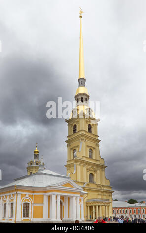 June 30, 2018- St. Petersburg, Russia: The exterior of Saint Peter and Paul Cathedral, showing the beautiful gold steeple and tourists on an overcast  - Stock Photo
