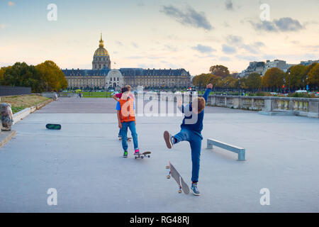 PARIS, FRANCE - NOVEMBER 9, 2018: Boys skating in the downtown of Paris in the evening, France - Stock Photo