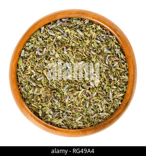 Herbes de Provence in wooden bowl. Mixture of dried herbs of the Provence, France. Savory, rosemary, thyme, lavender, oregano and marjoram. - Stock Photo