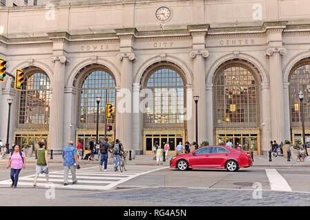 Pedestrian traffic on Public Square in front of Tower City Center in downtown Cleveland, Ohio, USA during the summer. - Stock Photo