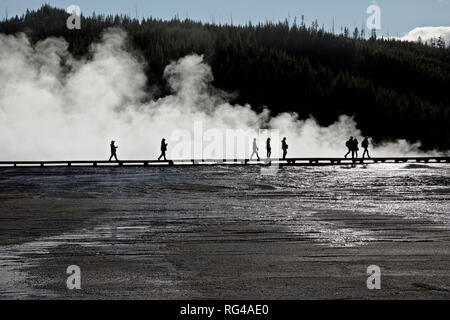 WY03000-00...WYOMING - Visitors walking the boardwalk at Grand Prismatic Spring in the Midway Geyser Basin of Yellowstone National Park. - Stock Photo