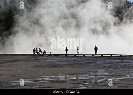 WY03001-00...WYOMING - Visitors walking the boardwalk at Grand Prismatic Spring in the Midway Geyser Basin of Yellowstone National Park. - Stock Photo