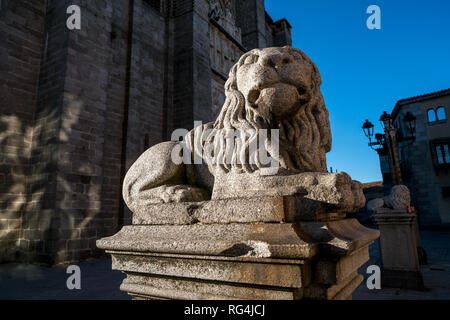 Statue of lion in front of Catedral of Ávila, Castile and León, Spain - Stock Photo