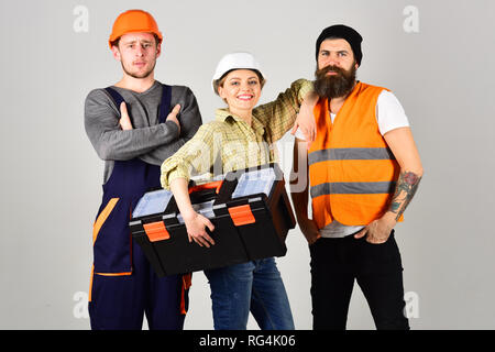 We are the great team. Construction workers team. Professional working team. Men and woman builders in workwear. Constructing engineers or architects - Stock Photo