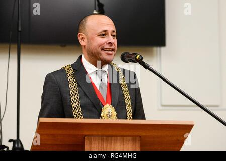 "London,UK. 27th Jan 2019.  Mayor of Lambeth, Councillor Christopher Wellbelove addresses the audience at a Holocaust Memorial Day ceremony held at Lambeth Assembly Hall.The theme for 2019 set by the Holocaust Memorial Day Trust is ""Torn from Home"".  Lambeth Council has agreed to resettle 28 families from the camps around Syria as well as  from other countries in the region. 25 families have arrived since April 2016. Credit: Claire Doherty/Alamy Live News - Stock Photo"