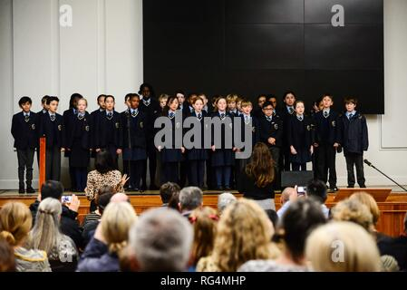 "London,UK. 27th Jan 2019.  Corpus Christi school choir perform  at a Holocaust Memorial Day ceremony held at Lambeth Assembly Hall.The theme for 2019 set by the Holocaust Memorial Day Trust is ""Torn from Home"".  Lambeth Council has agreed to resettle 28 families from the camps around Syria as well as  from other countries in the region. 25 families have arrived since April 2016. Credit: Claire Doherty/Alamy Live News - Stock Photo"