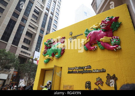 Hong Kong, China. 27th Jan, 2019. An installation of auspicious animals from Chinese mythology is seen at a fair in Times Square in Hong Kong, south China, Jan. 27, 2019. With appealing design and connotation of luck and fortune, the fair attracted many visitors. Credit: Wu Xiaochu/Xinhua/Alamy Live News - Stock Photo