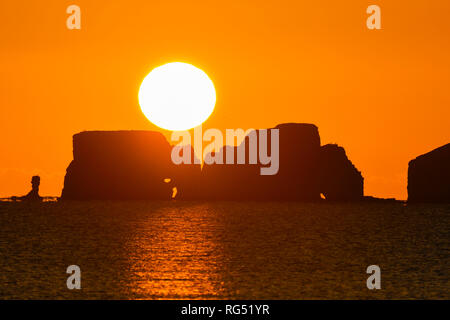 Studland, Dorset, UK. 28th Jan, 2019. UK Weather. View from Studland of the sun rising up from behind Old Harry Rocks on the Dorset Jurassic Coast near Swanage. Picture Credit: Graham Hunt/Alamy Live News - Stock Photo
