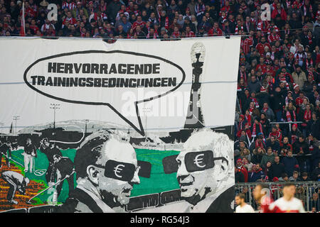 fans against Uli HOENESS (FCB President ), FCB President and chairman, Karl-Heinz RUMMENIGGE (CEO, Vorstandsvorsitzender FCB AG) and their junior performance center, supporters, spectators, club flags,  celebration, fan, wave, colors, sea of flags, soccerfan, clothes, drawings, masquerade, football, jacket, cowl, waistcoat, fanfare, scarves, mask,   banners, show, presentation, message, communication, fan choreography, fan curve, FC BAYERN MUNICH - VFB STUTTGART 4-1  - DFL REGULATIONS PROHIBIT ANY USE OF PHOTOGRAPHS as IMAGE SEQUENCES and/or QUASI-VIDEO -  1.German Soccer League , Munich, Janu - Stock Photo