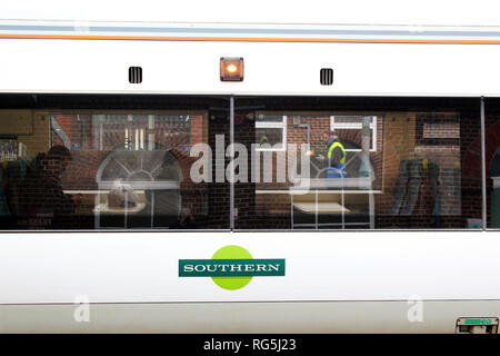 Southern train coach carriage with passengers in platform station, England, UK - Stock Photo