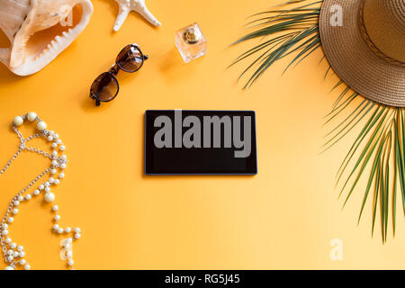 Summer background with a black tablet - Stock Photo