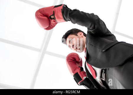 close up.serious businessman in Boxing gloves - Stock Photo