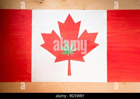 cannabis leaf on canadian flag, marijuana legalization concept - Stock Photo