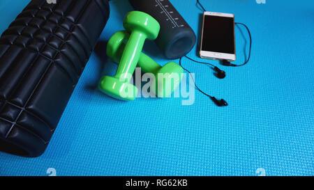 Foam Roller Gym Fitness Equipment Blue background self Myofascial Release - Stock Photo