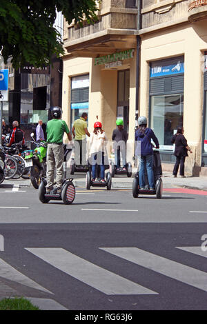 ZAGREB, CROATIA - JUNE 12, 2013: Group of Tourists Visiting the City on Segways - Stock Photo