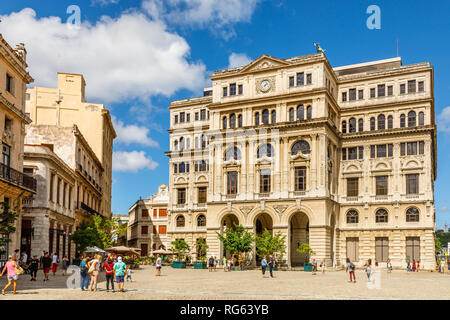Old square with old spanish building with clock, plaza Vieja, center of Old Havana, Cuba - Stock Photo