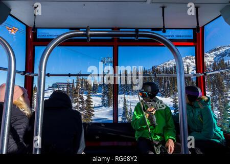 WHISTLER, BC, CANADA - JAN 14, 2019: Inside a gondola car of the the Peak 2 Peak gondola looking towards Blackcomb. - Stock Photo